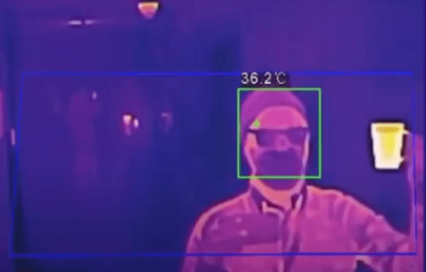 Image of thermal camera reading despite interference of mask or hot drink